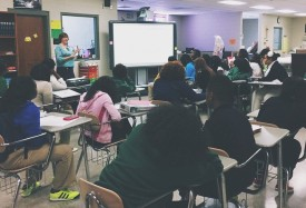 Amanda Dubois conducts orientation for Bridging the Gap at Jackson-Olin High School earlier this year.