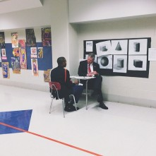 AT&T Alabama President Fred McCallum sits with Carver student Jharin Dunson for pre-mock interviews at Carver last week.